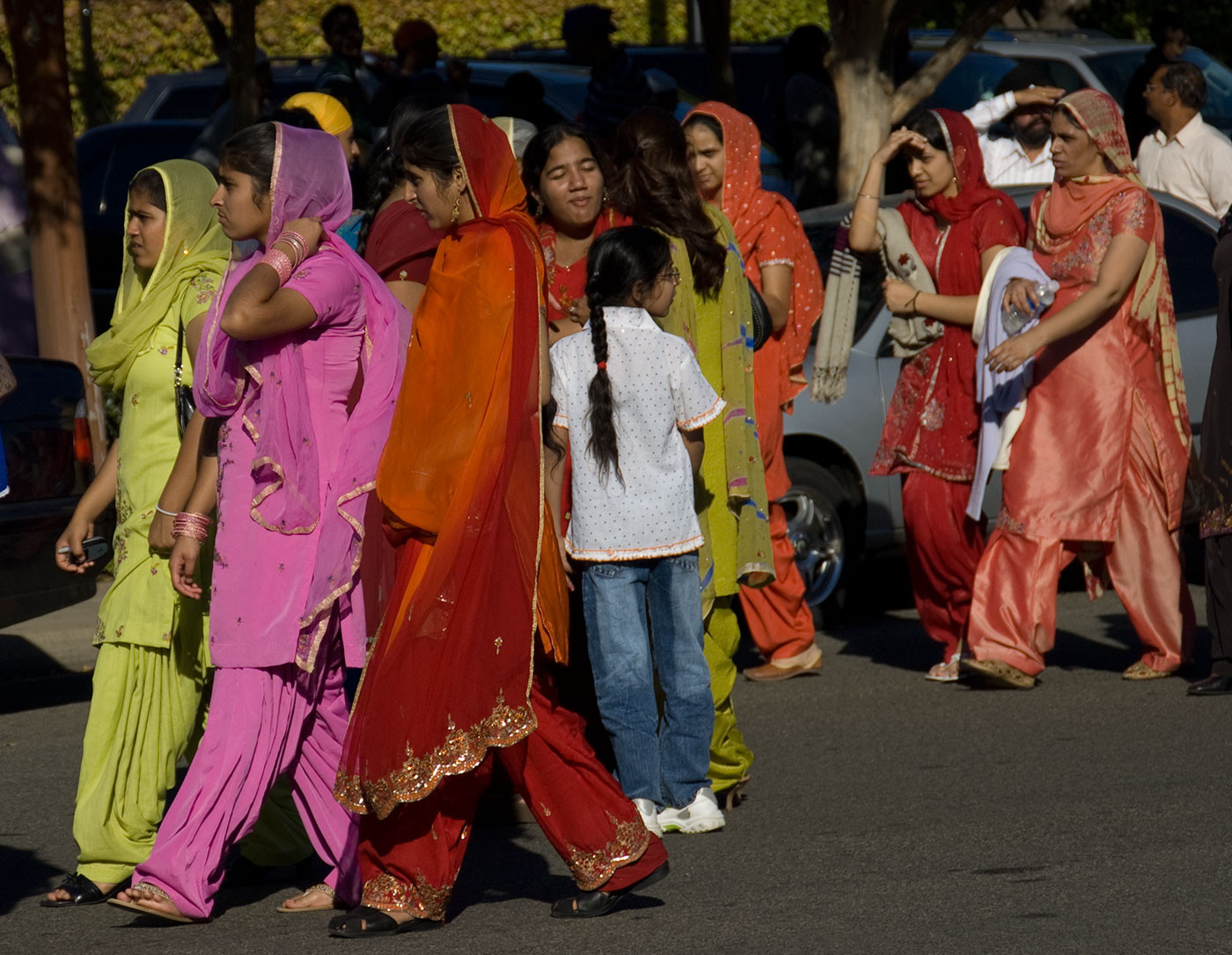 Photo of a group of colorfully dressed women in Yuba City during a parade by Marge d'Wylde